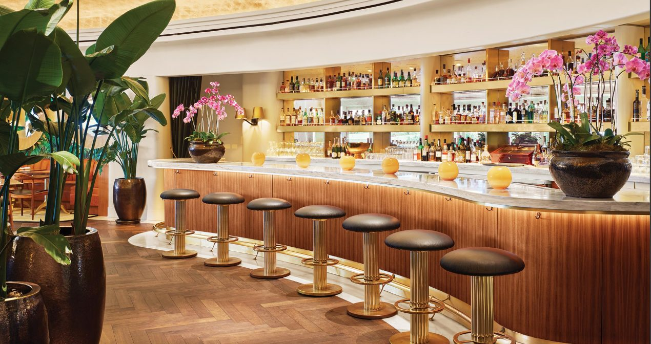 Fancy bar lined with stools