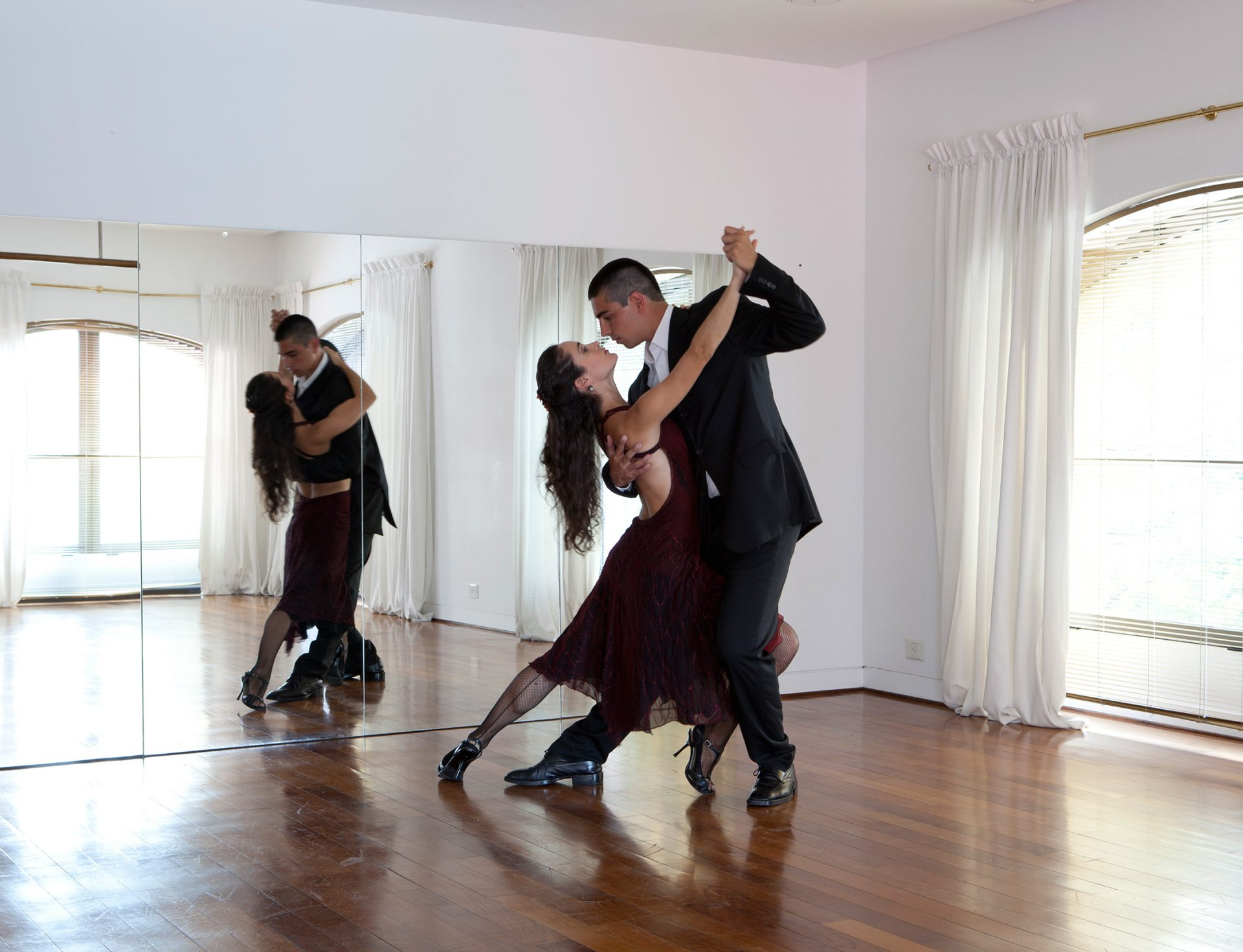 two couples dance the tango
