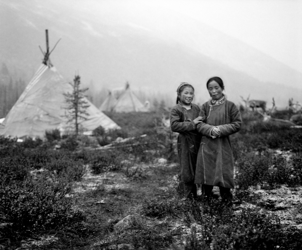 Two Mongolian girls in field