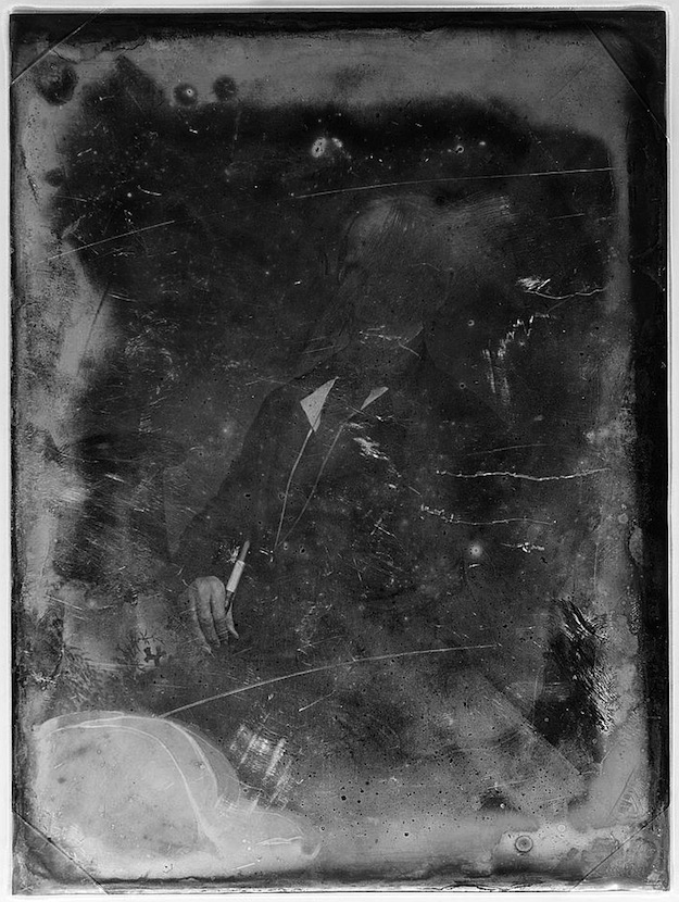 Daguerreotype portrait of a man with a top hat