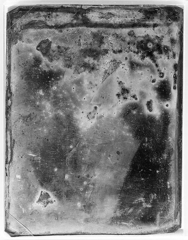 Daguerreotype portrait that has degraded with time