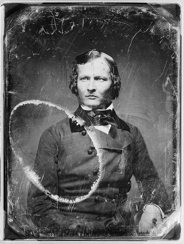 Daguerreotype portrait of a man in a suit, seated