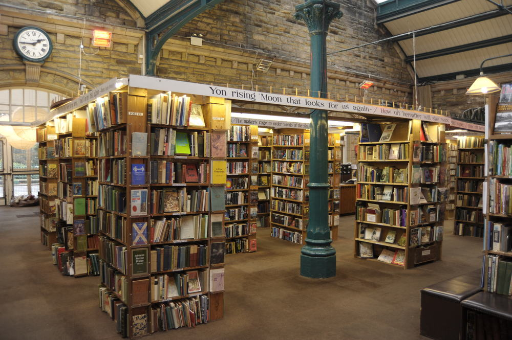 stacks of bookshelves in an airy brick building
