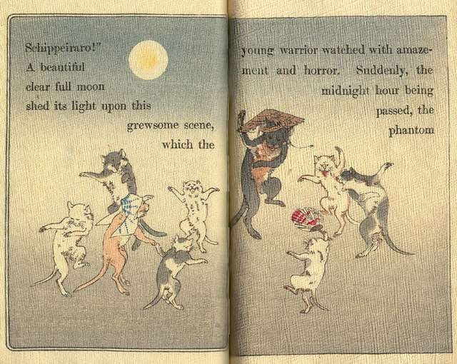 page from Japanese fairytale book with dancing cats