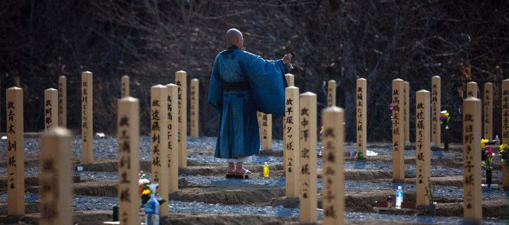 A traditional shinto ritual in a graveyard