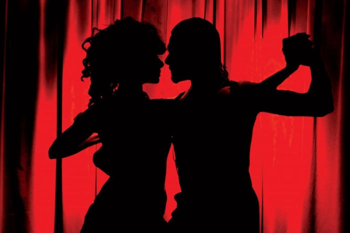 man and woman in silhouette dance the tango