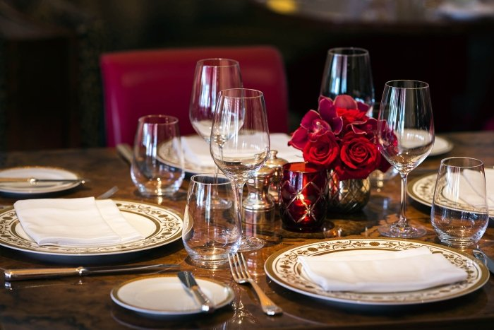 table setting with rose centerpieces