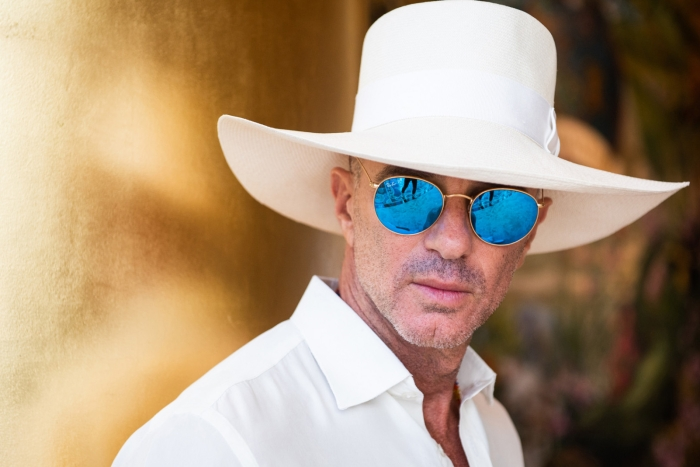 alan faena in sunglasses and a white hat