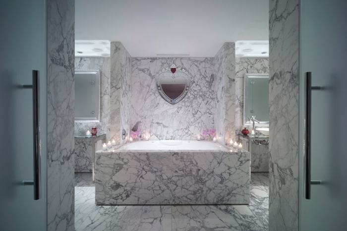 large marble bathtub in hotel suite