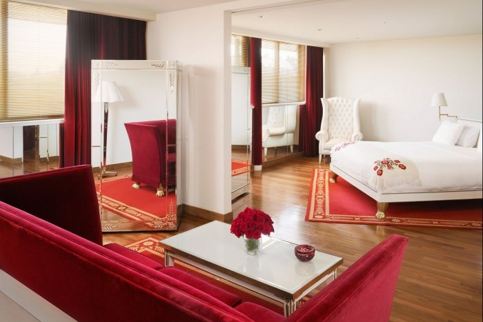 hotel suite with bed and seating area