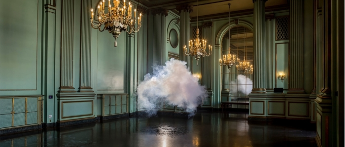 A cloud floats inside an opulent rook with gold chandeliers.