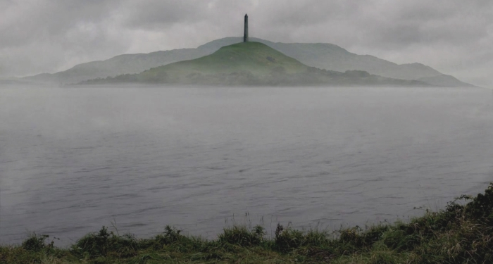 An island with a pointed tower shrouded in mist.