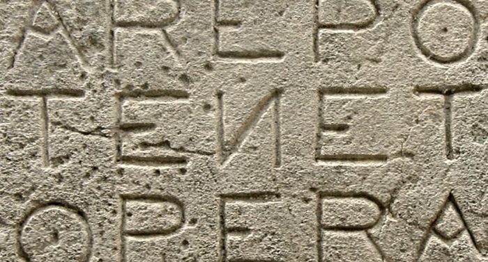 Latin words carved in stone