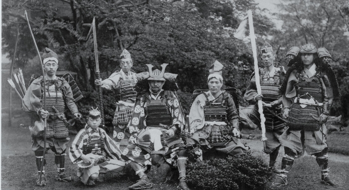 Black and white photo of samurai warriors in traditional armor.