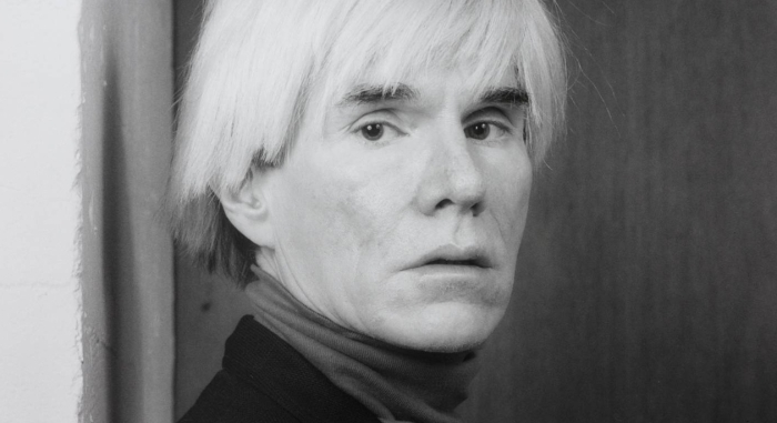 Greyscale portrait of Andy Warhol.