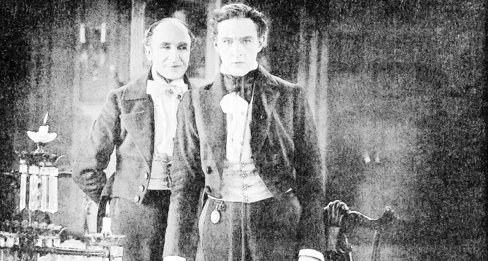 Black and white photo of well-dressed man and his butler.