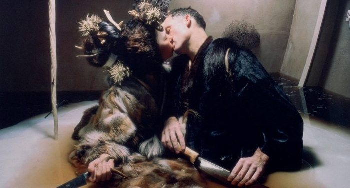 Couple wearing furs, embracing