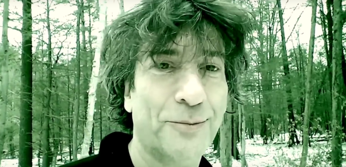 Author Neil Gaiman in the woods