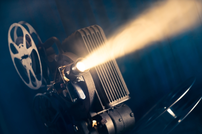 traditional movie projector with light coming from lens