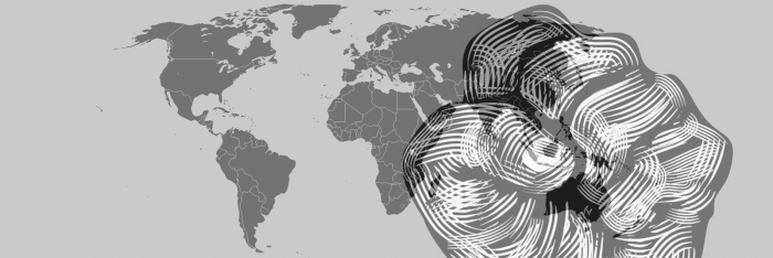 drawing of a fist in front of a world map