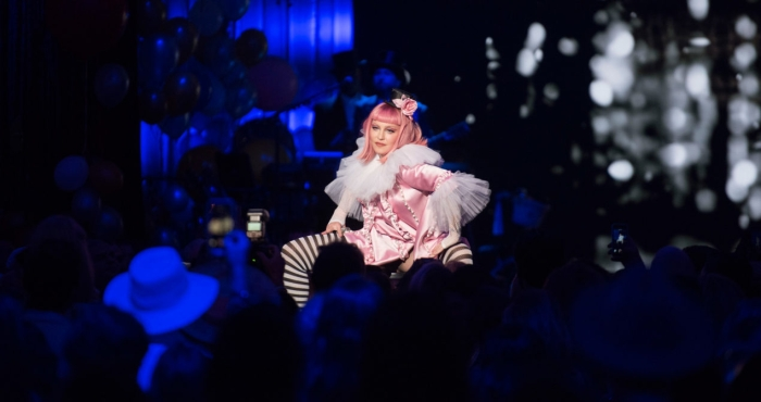 madonna performs on stage wearing pink wig and black & white striped socks