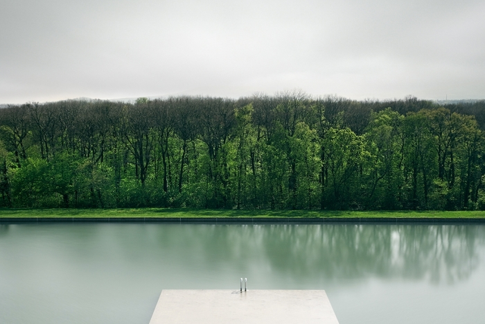 a lake before a forest