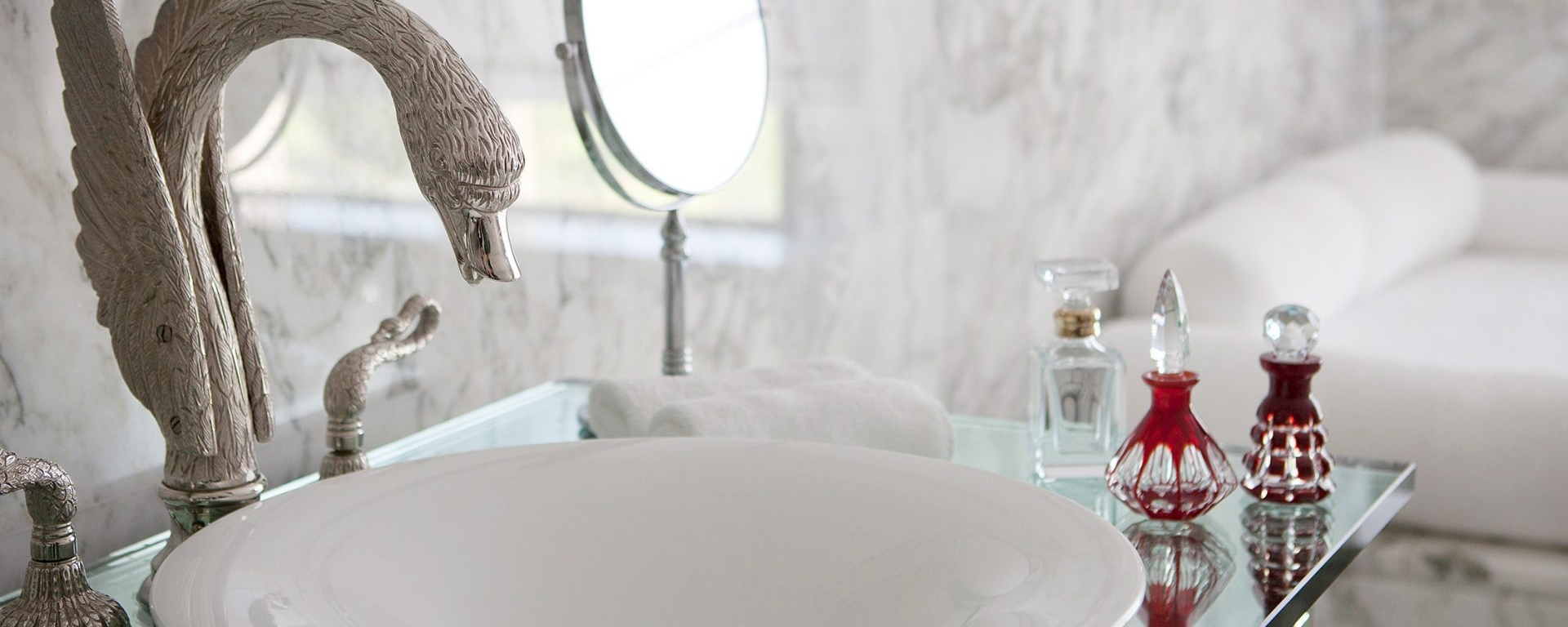 basin sink with swan faucet in tower suite