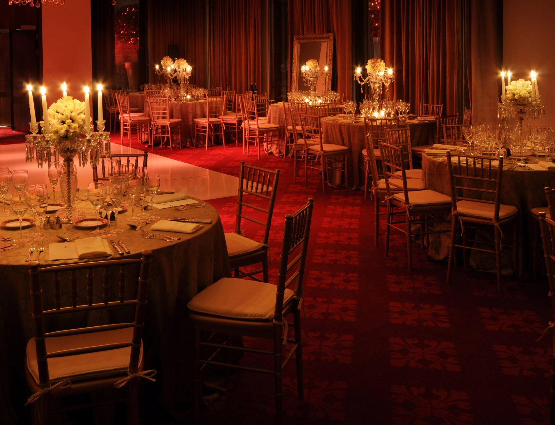Interior view of the ballroom with reception tables and candle light