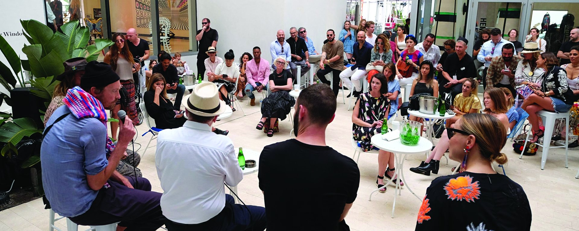 Group of people in a talk at Faena Bazaar