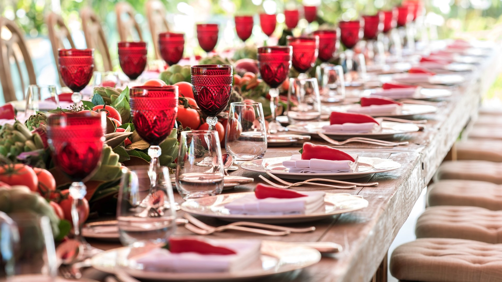 long table with place settings and wine glasses
