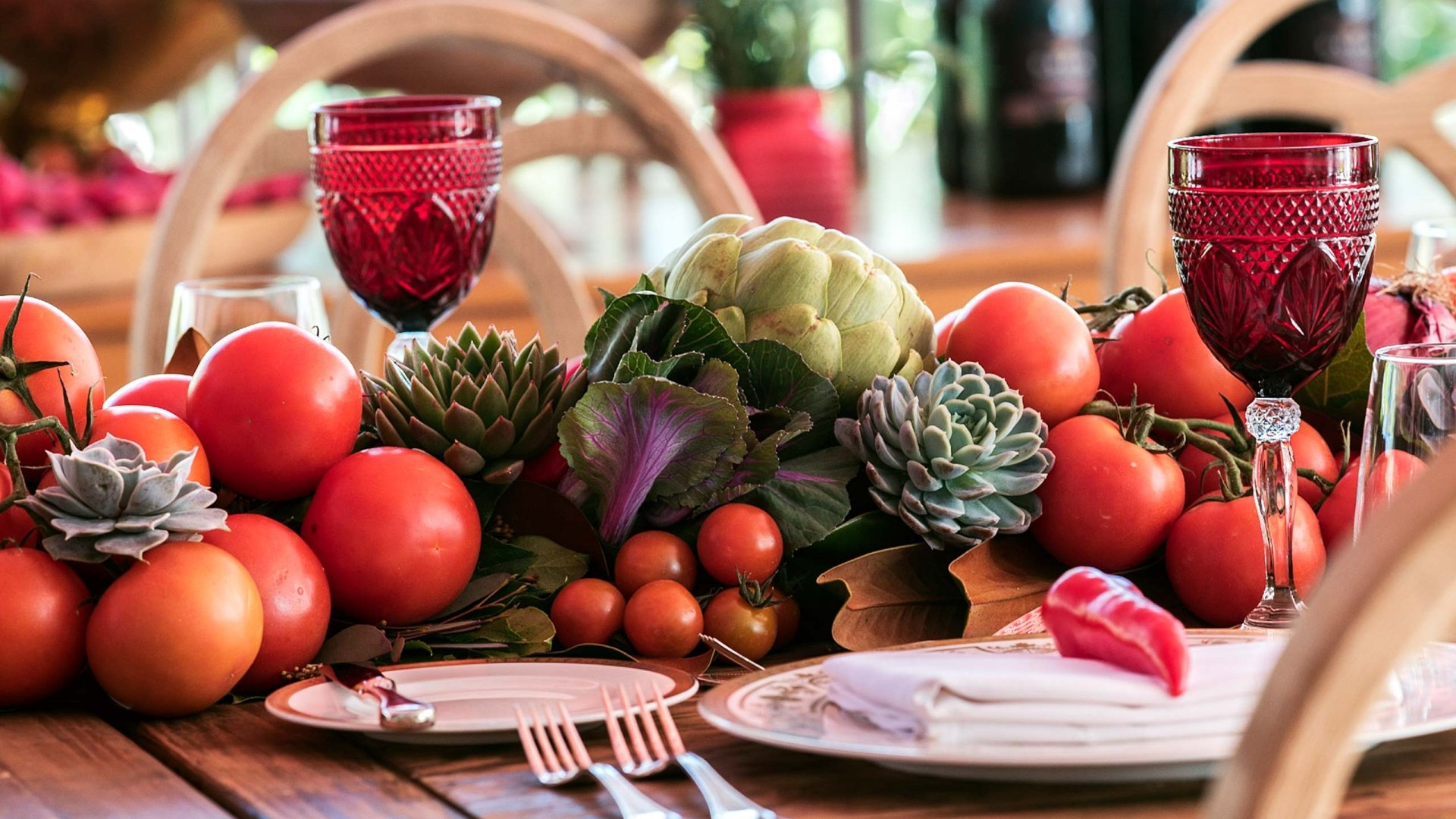 table setting with tomatoes and artichokes