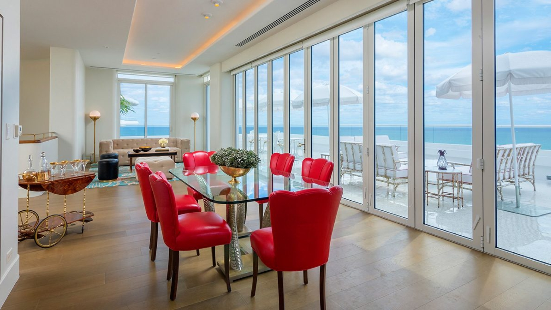 dining area in hotel penthouse with a wall of windows