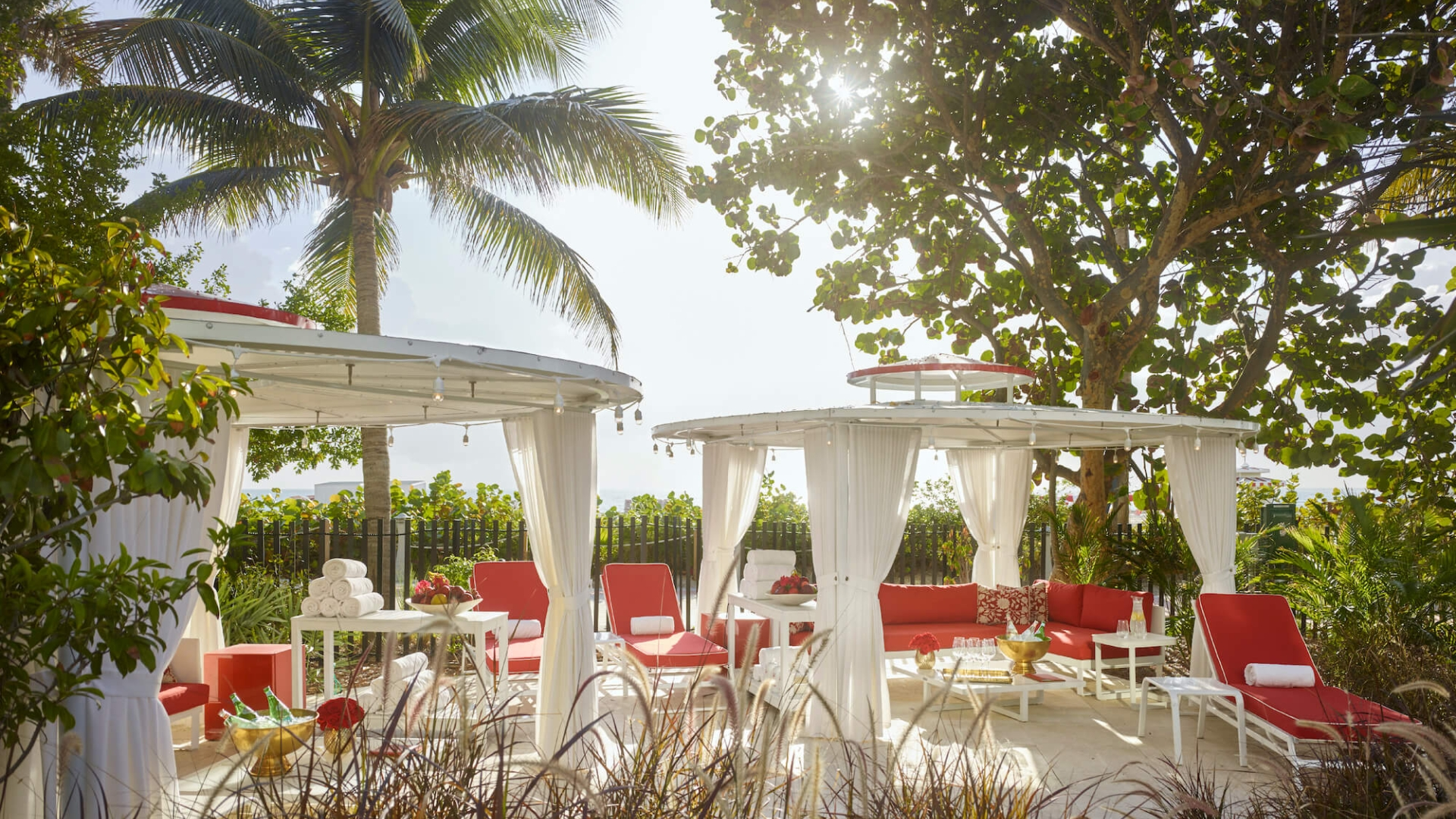 white cabanas with red lounge chairs