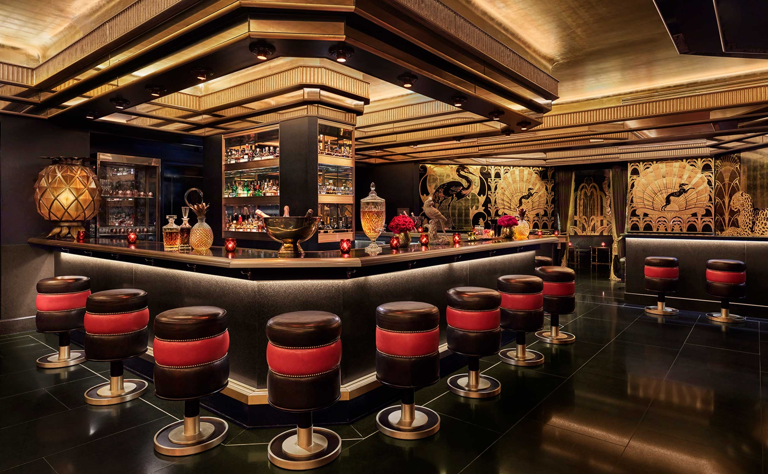 saxony bar interior with red and black stools at the bar