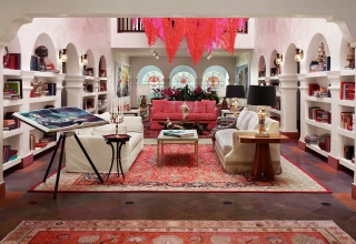 casa faena atrium with bookshelves and couches