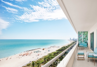 balcony of a hotel suite looking over miami beach