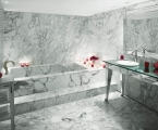 marble bathtub and sink area in hotel suite